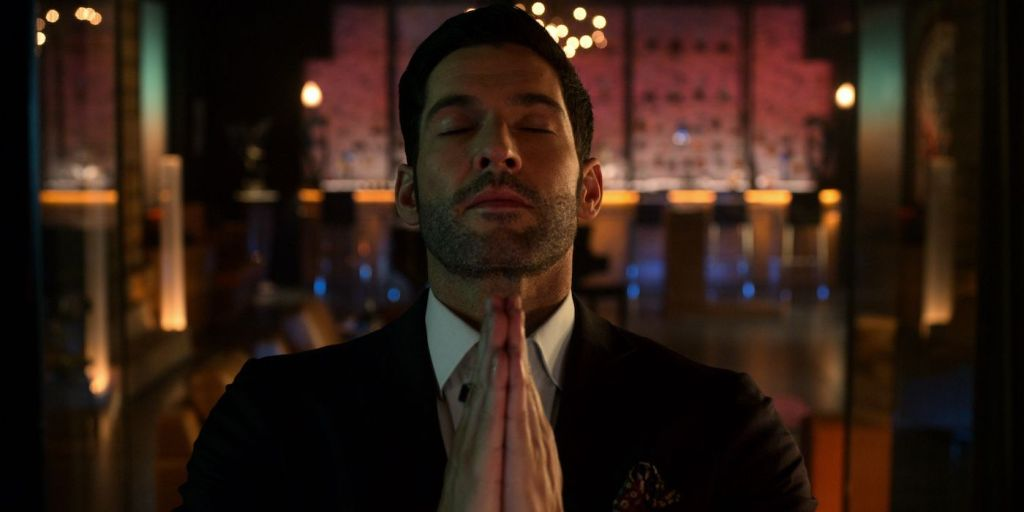 Tom Ellis as Lucifer Morningstar praying in Netflix's Lucifer