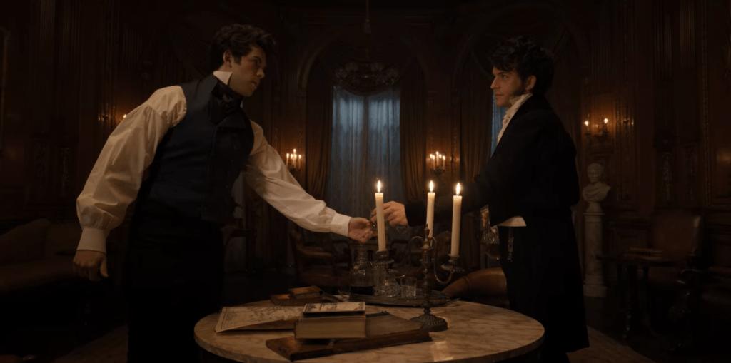 "(L-R) Luke Newton as Colin Bridgerton and Jonathan Bailey as Anthony Bridgerton share a drink in Bridgerton's ""Oceans Apart"""