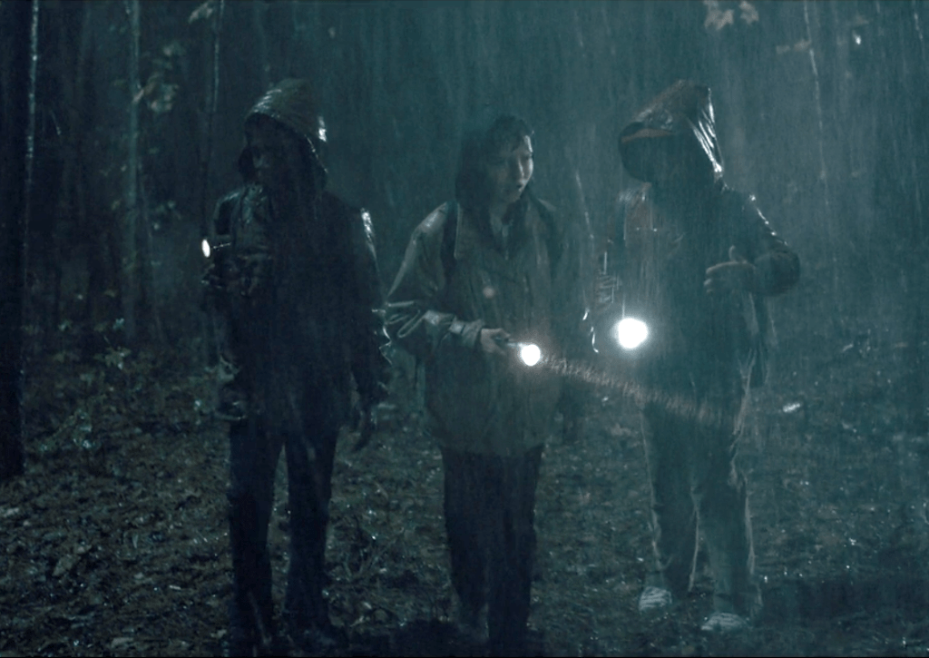 """Mike (Finn Wolfhard), Will Byers (Noah Schnapp), Dustin Henderson (Gaten Matarazzo), and Lucas Sinclair (Caleb McLaughlin) go searching for Will Byers (Noah Schnapp) in the wood in Stranger Things' """"The Vanishing of  Will Byers"""""""