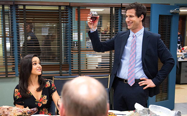 """BROOKLYN NINE-NINE: Det. Jake Peralta (Andy Samberg, R) gives a toast in the all-new """"Thanksgiving"""" episode of BROOKLYN NINE-NINE airing Tuesday, Nov. 26 (8:30-9:00 PM ET/PT) on FOX. Also pictured Melissa Fumero. ©2013 Fox Broadcasting Co. Cr: Eddy Chen/FOX"""