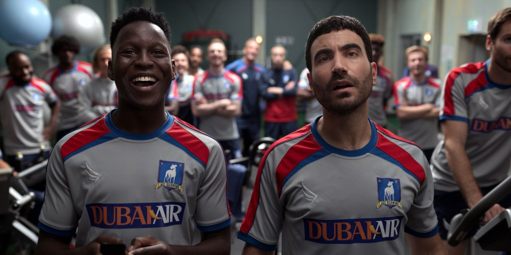 """Toheeb Jimoh and Brett Goldstein in """"Ted Lasso,"""" now streaming on Apple TV+."""