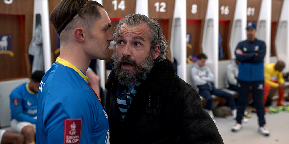 """Phil Dunster and Kieran O'Brien in """"Ted Lasso"""" season two, episode """"Man City"""" now streaming on Apple TV+."""
