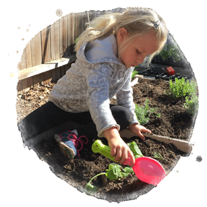 child gardening at school
