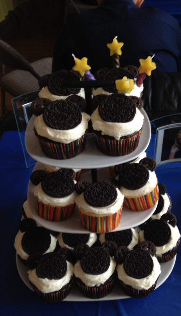 Oreo topped cupcakes on a 3 tiered cake stand.