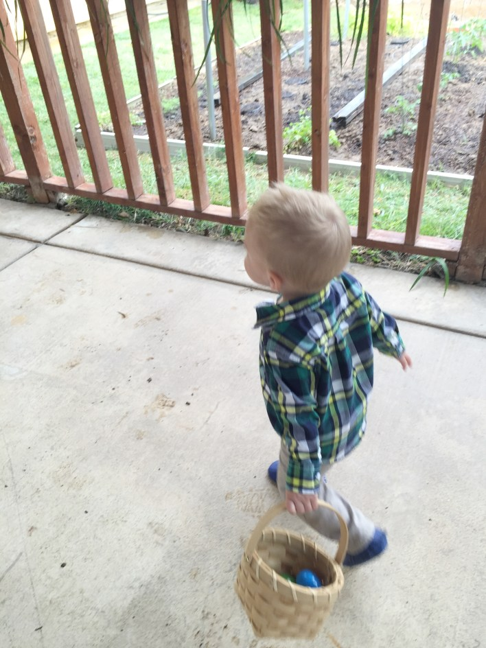 Little boy running with basket of Easter eggs