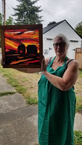 Kathy Wise with her sunsets and silloette piece made in Kory Dollar's workshop