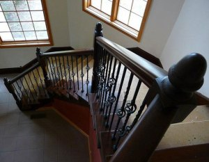 Rich dark wood iron and banister staircase