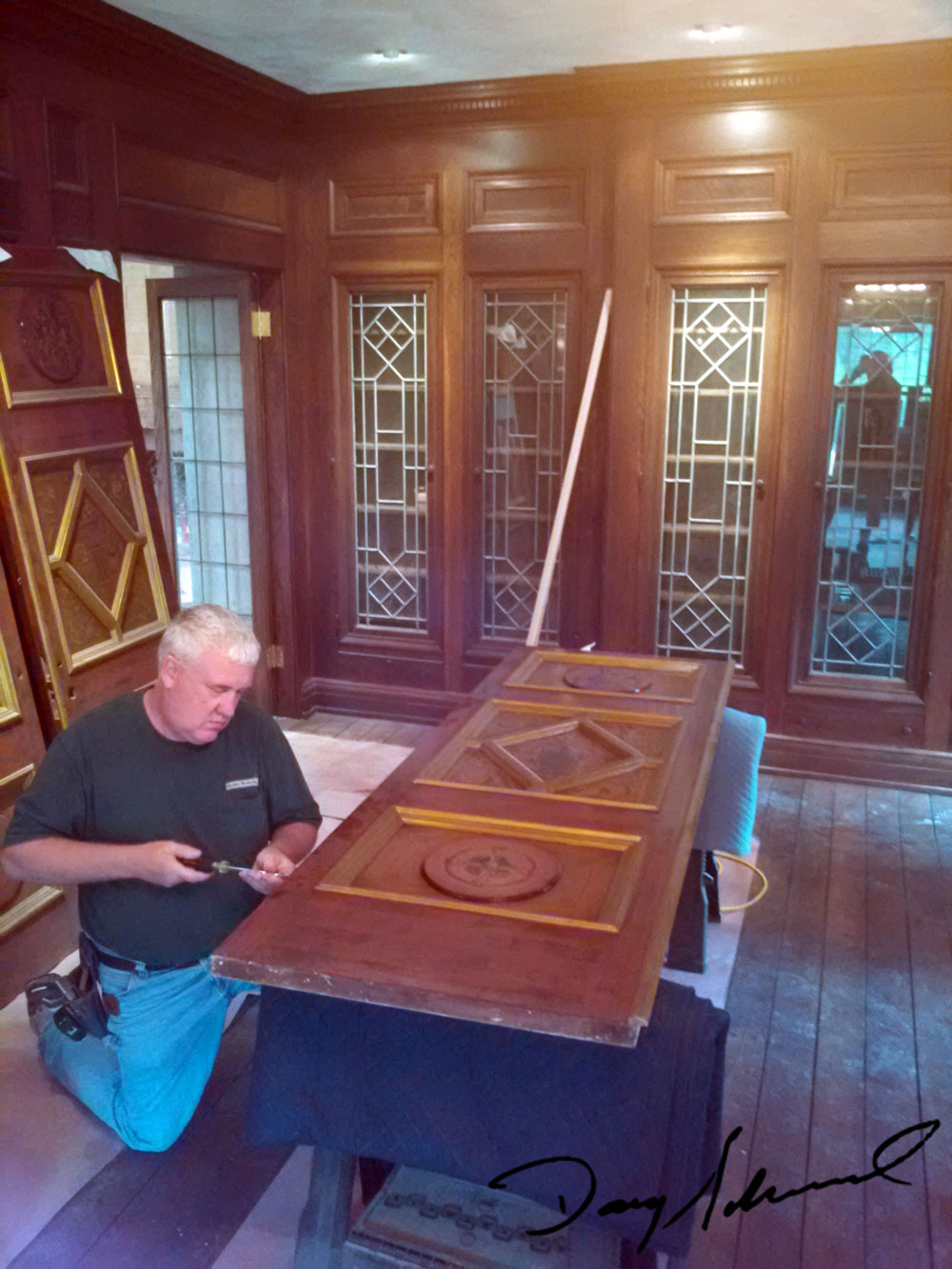Doug Marvel at work on one of the intricate doors at the Parry Mansion