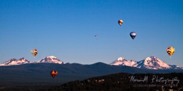 Bend, Oregon; Near peak of Pilot Butte looking westward; Early morning lift-off