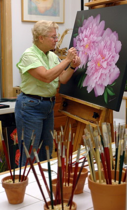 Newsday photo of Mary Ahern painting in studio