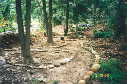 First hose and then rocks help to define the woodland walkways