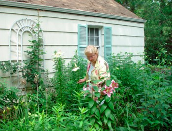 Mary Ahern in her Perennial Garden