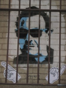 HaHa   Mario Condello (behind bars)