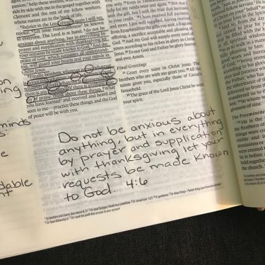 "A photo of the Bible where I journaled the verse Philippians 4:6 which states, ""Do not be anxious about anything, but in everything by prayer and supplication with thanksgiving let your requests be made known to God."""