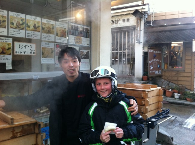 Mitchell buying oyaki in the main street of Nozawa Onsen