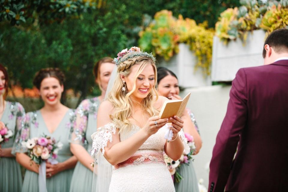 Bride reading vows at wedding - www.marycostaweddings.com