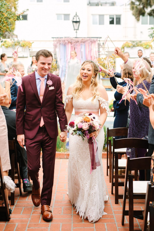 Wedding exit with bride and groom - www.marycostaweddings.com