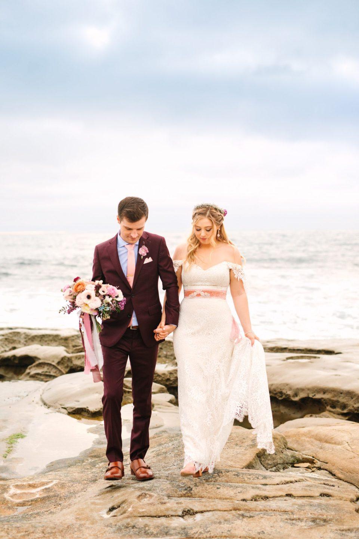 Bride and groom walking at the beach - www.marycostaweddings.com
