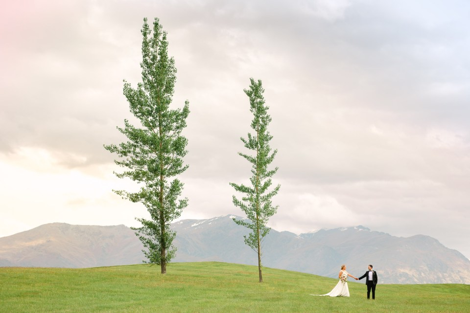 Millbrook Resort New Zealand wedding couple with two trees by Mary Costa Photography