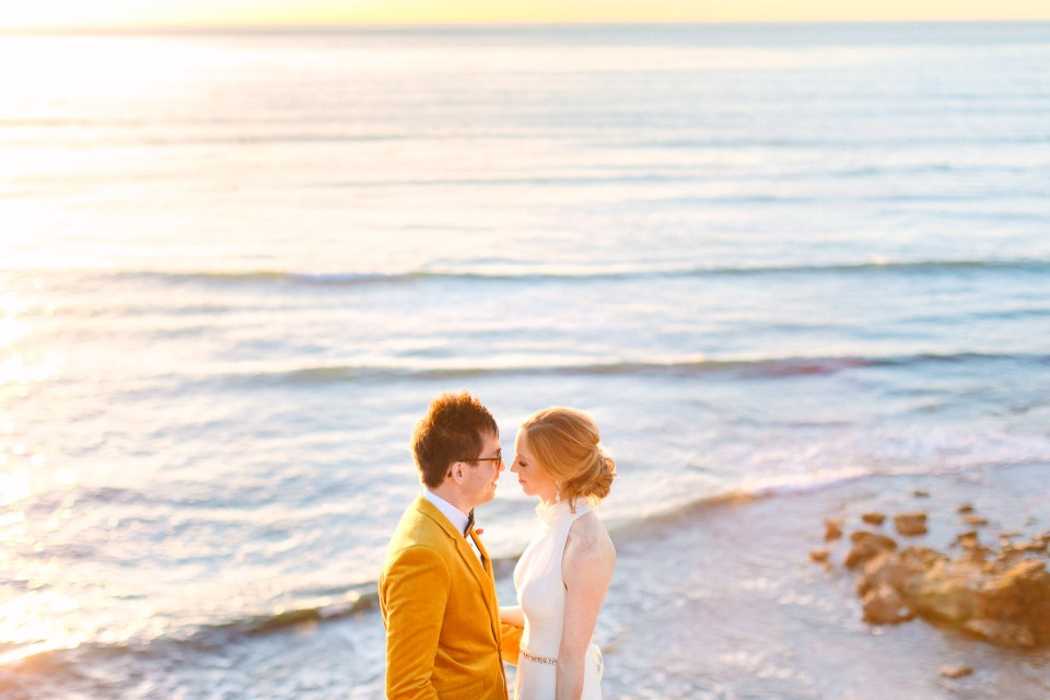 Wedding couple at the ocean during sunset by Mary Costa Photography