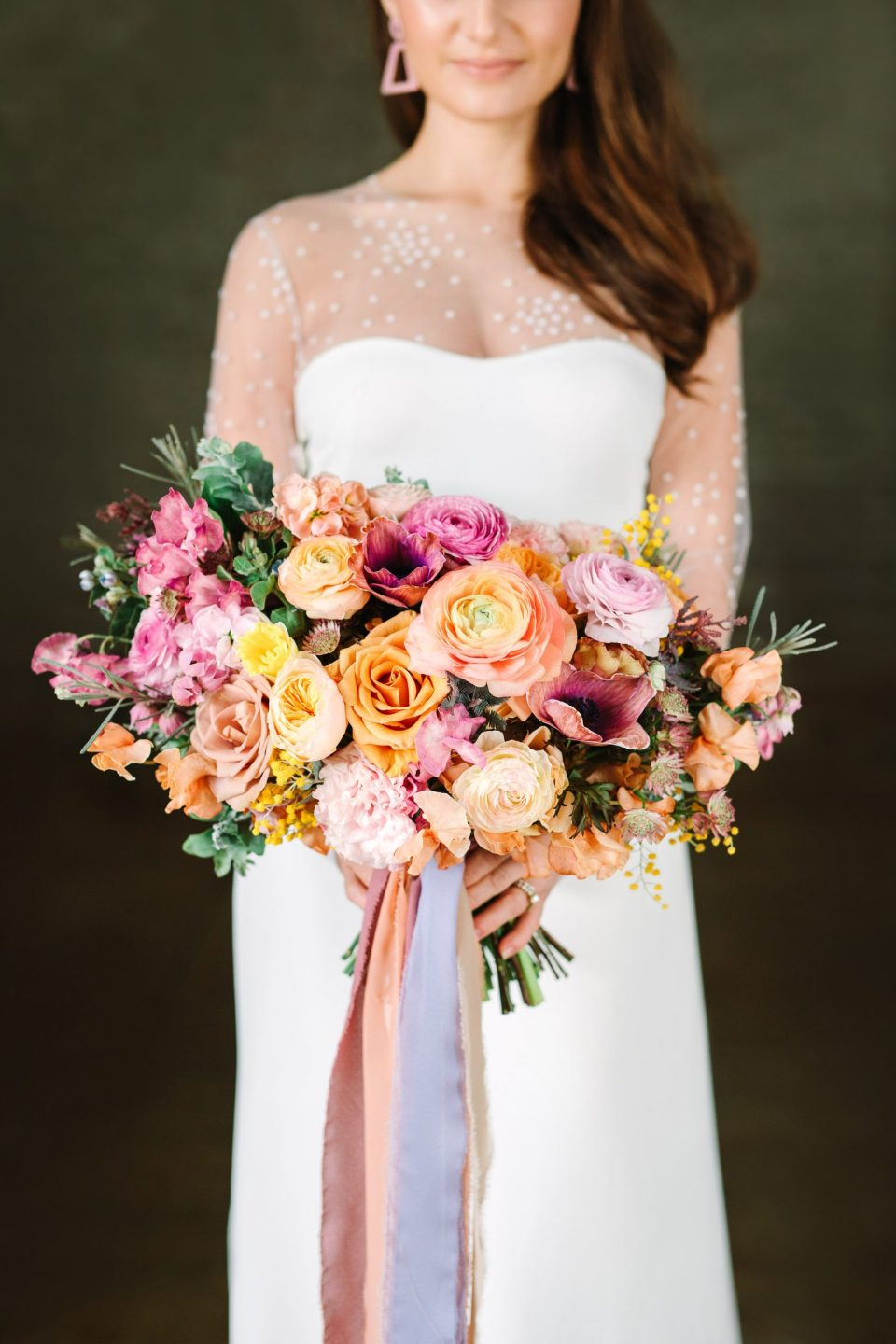 Bride with colorful bouquet by Mary Costa Photography