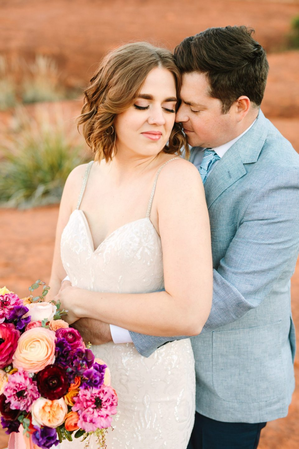 Couple snuggling in Sedona by Mary Costa Photography