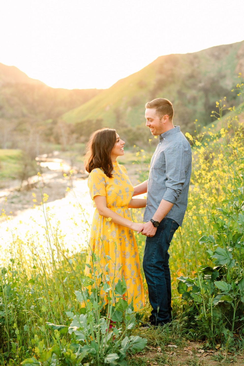 Couple in Malibu Creek Park with blooming mustard seed by Mary Costa Photography