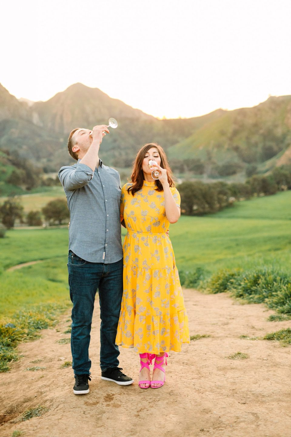Couple drinking champagne during engagement session by Mary Costa Photography