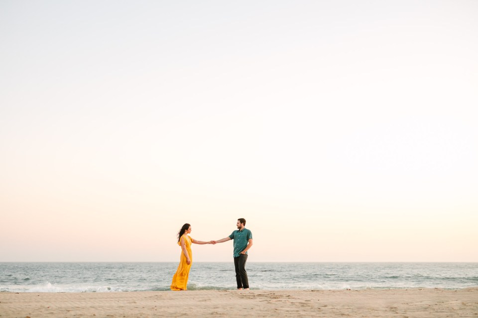 Couple at Leo Carillo Beach by Mary Costa Photography