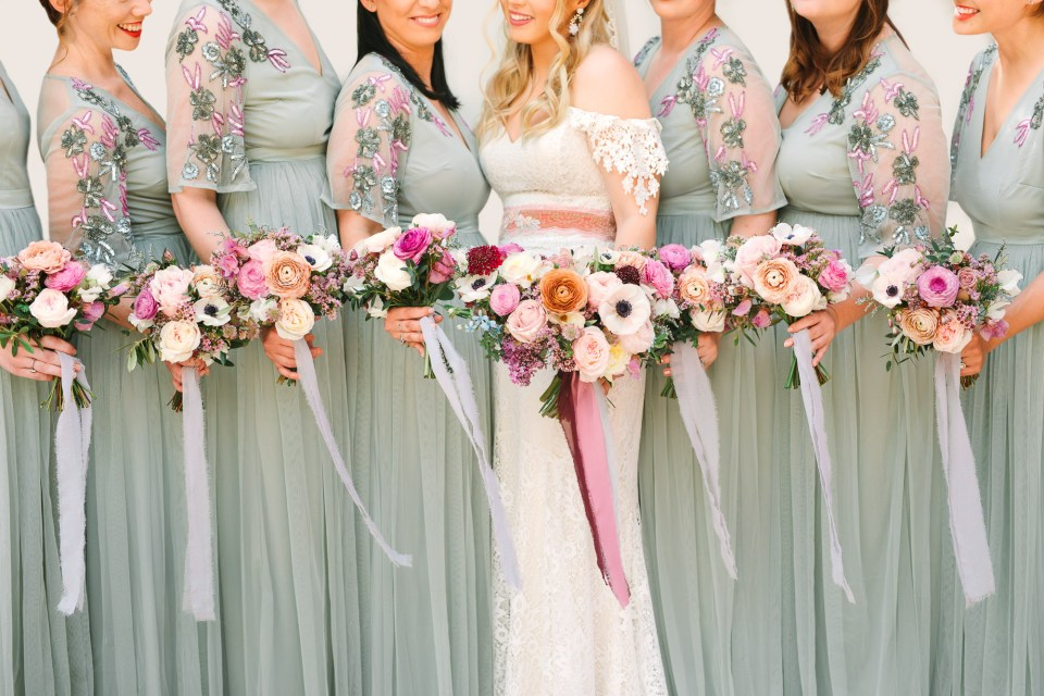 Bride and bridesmaids with bouquets by Mary Costa Photography
