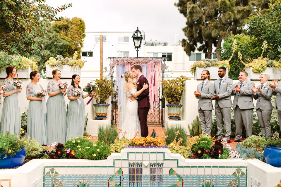 Wedding ceremony first kiss at Darlington House La Jolla by Mary Costa Photography