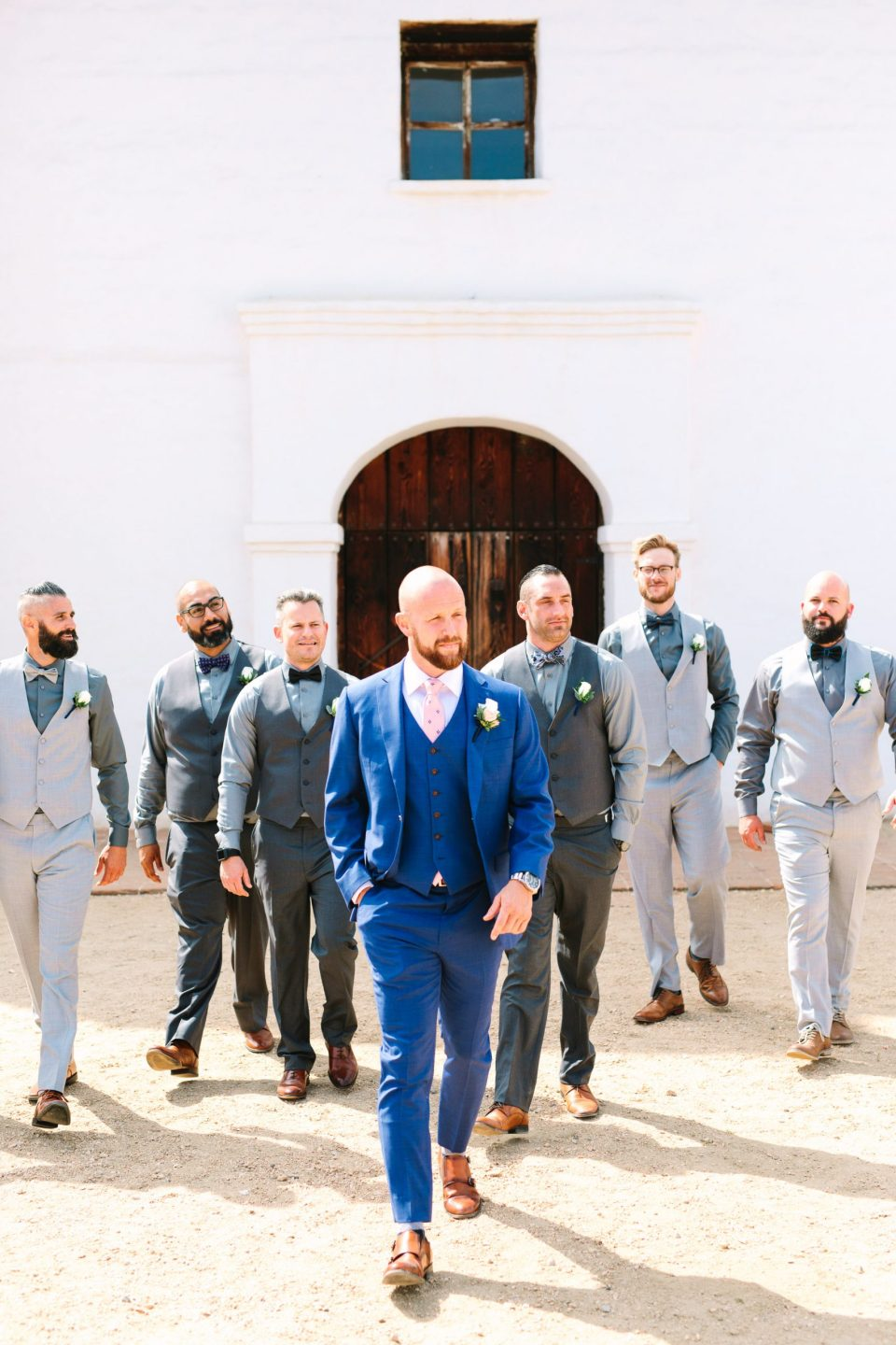 Groomsmen walking in Santa Barbara by Mary Costa Photography