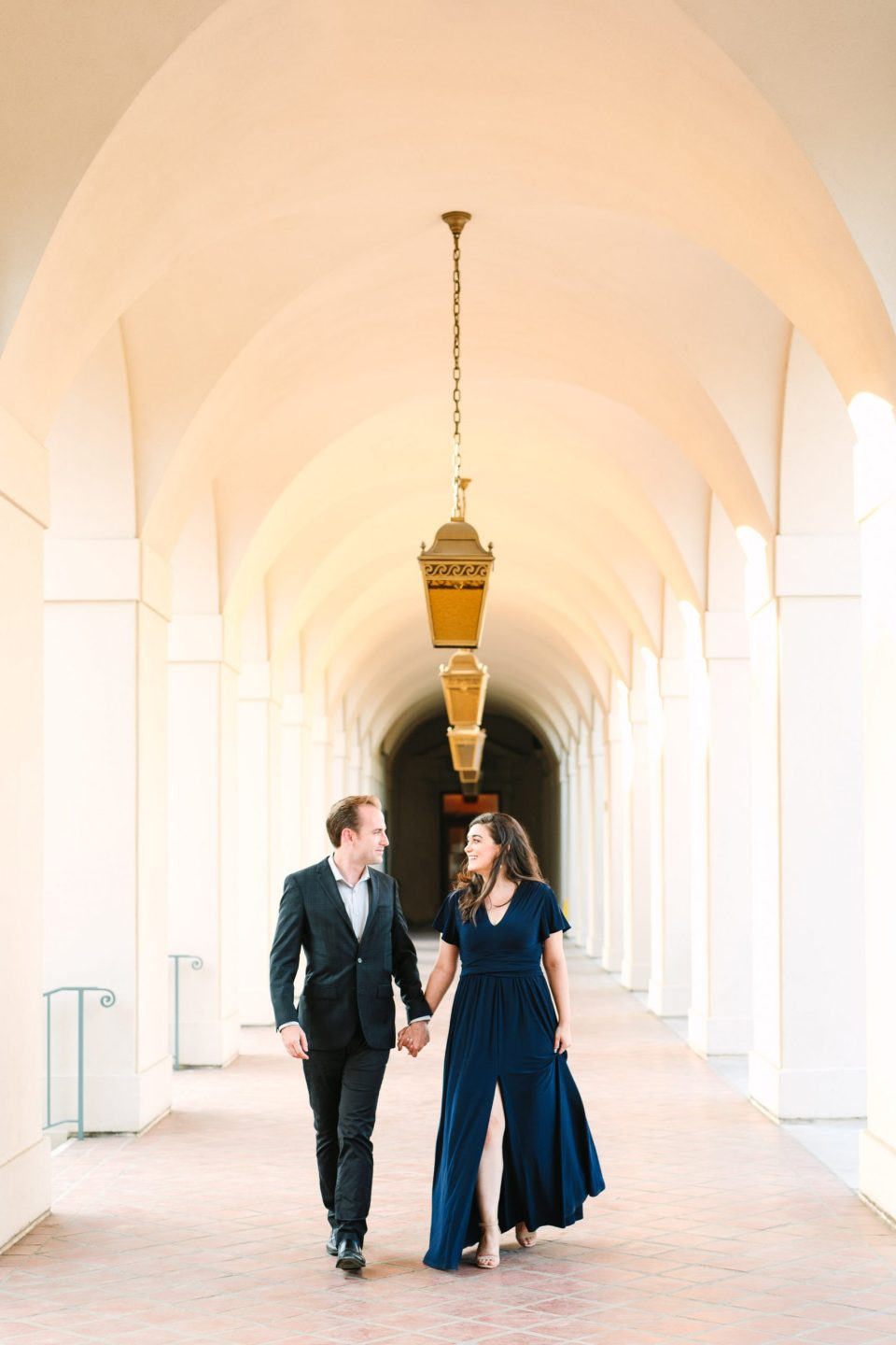 Couple walking at Pasadena Town Hall by Mary Costa Photography