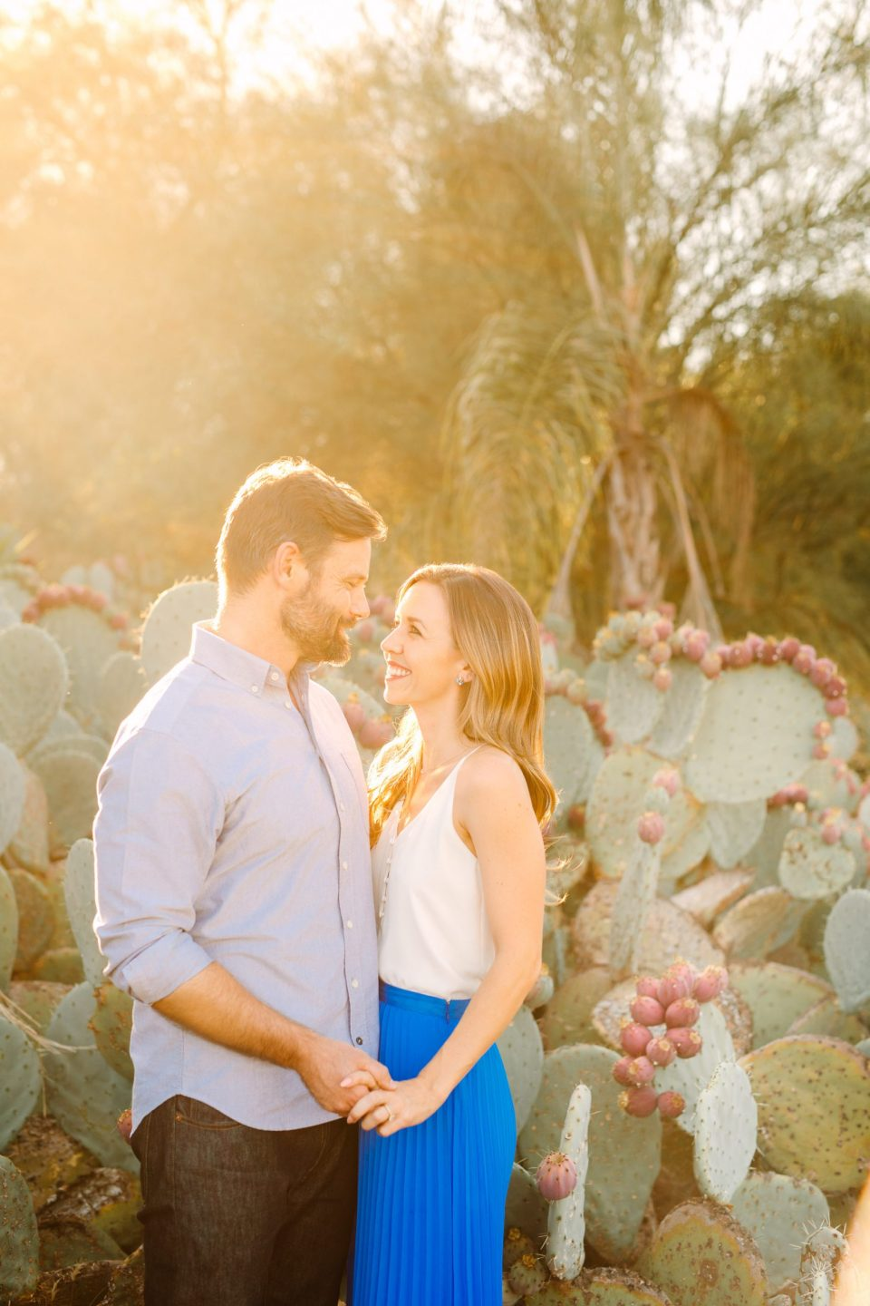 Couple in cactus garden by Mary Costa Photography
