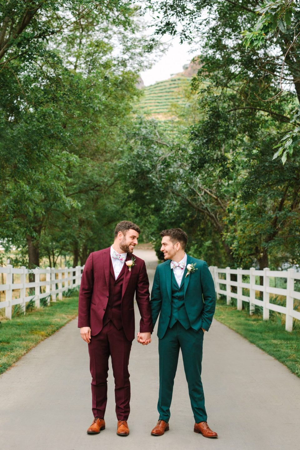 Two grooms holding hands by Mary Costa Photography