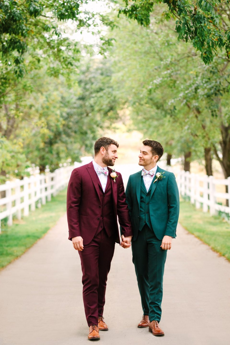 Two grooms walking by Mary Costa Photography