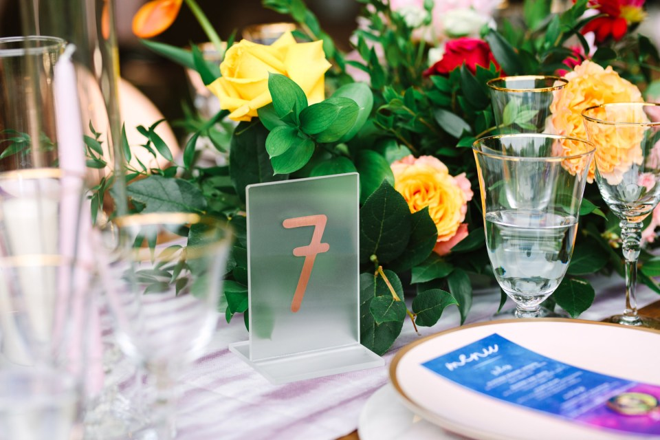Table number at wedding reception by Mary Costa Photography