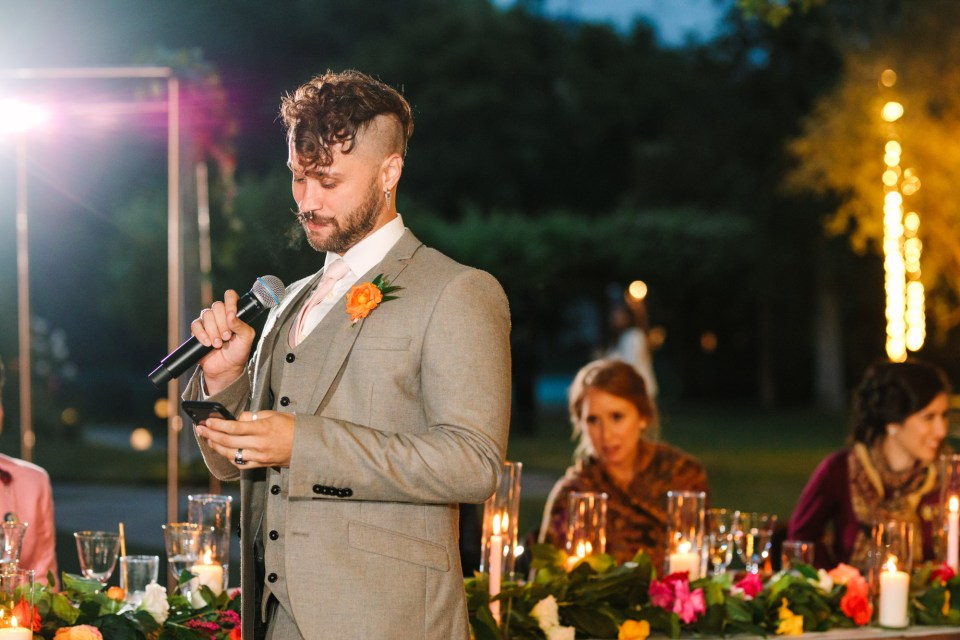 Best man giving speech by Mary Costa Photography