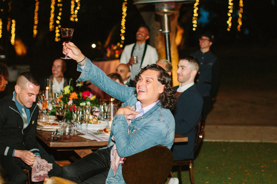 Wedding guests toasting by Mary Costa Photography