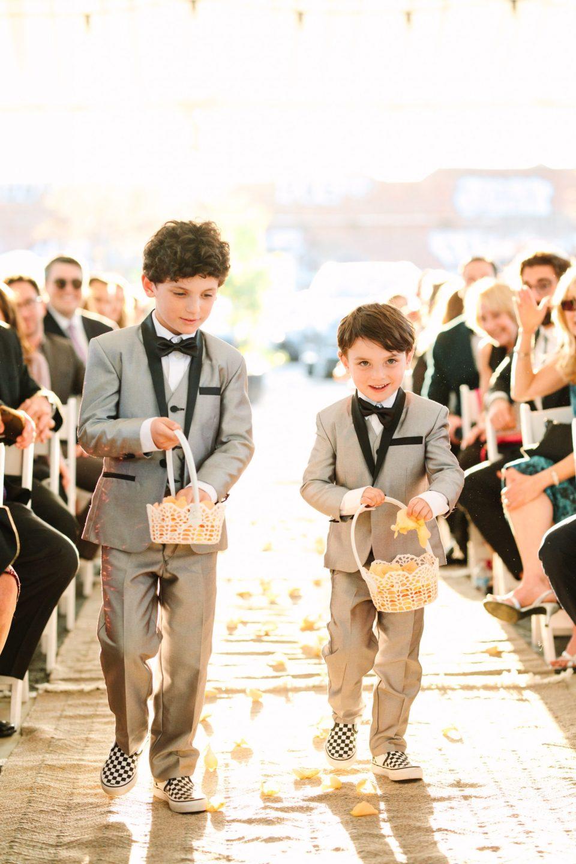 Ring bearers at wedding ceremony www.marycostaweddings.com