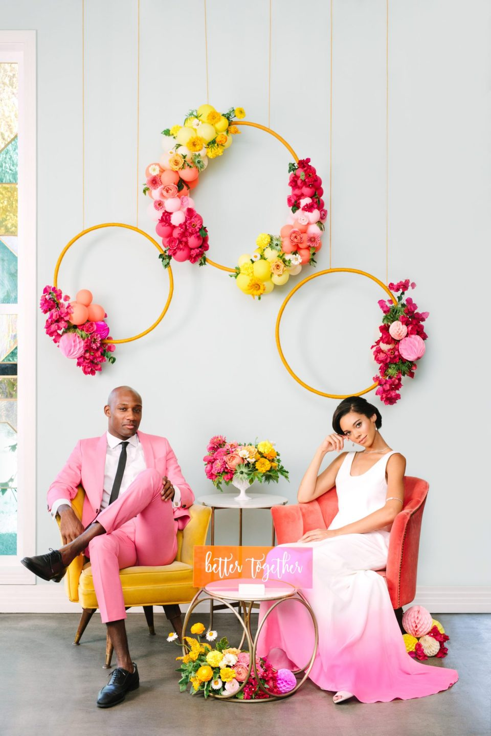 Groom in pink suit and bride in dip-dyed pink dress with ombre floral accents - www.marycostaweddings.com
