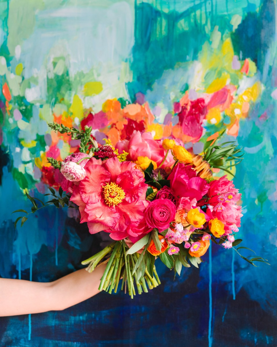 Colorful bouquet in front of painting at Fig House - www.marycostaweddings.com
