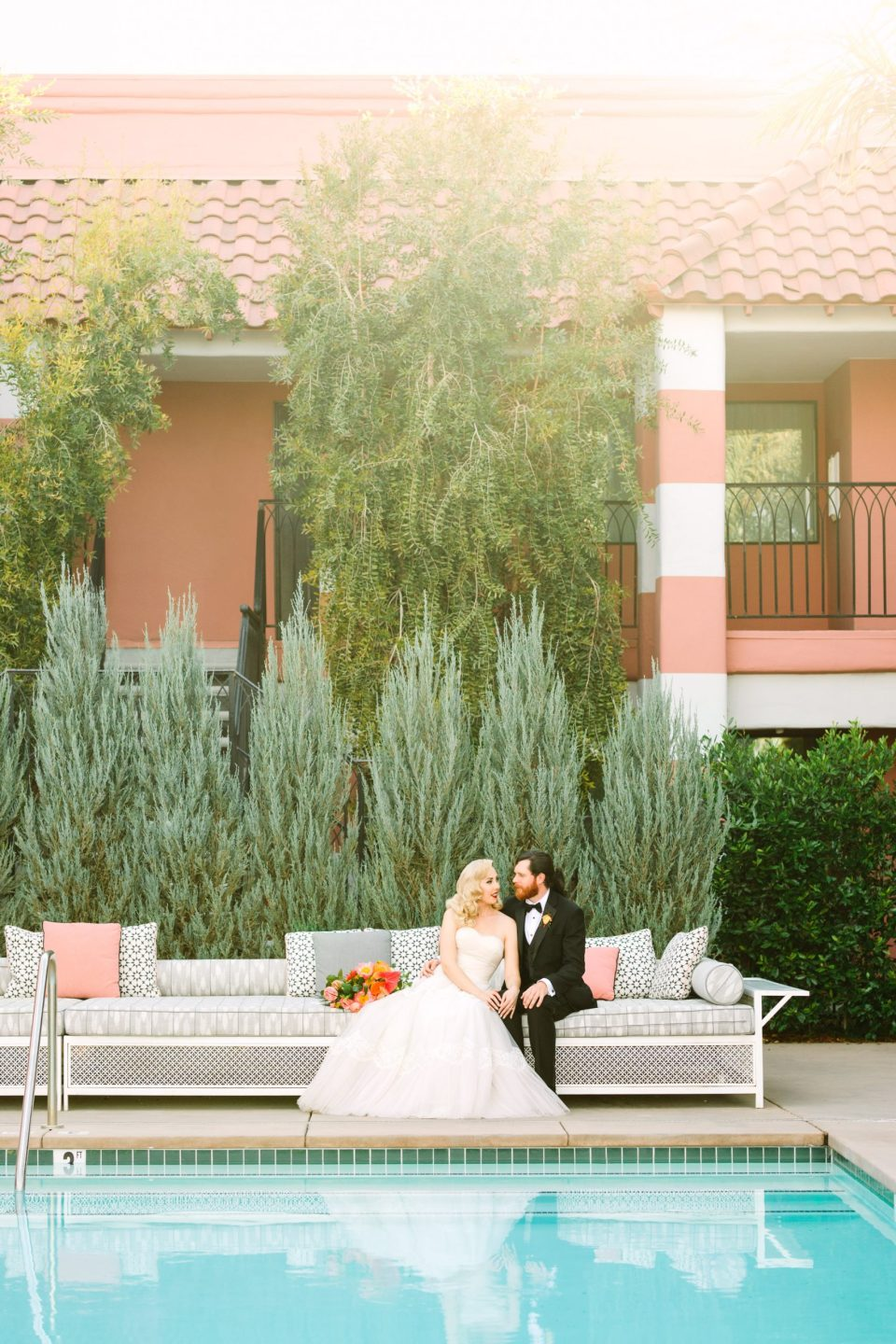 Bride and groom by pool at Sands Hotel - www.marycostaweddings.com