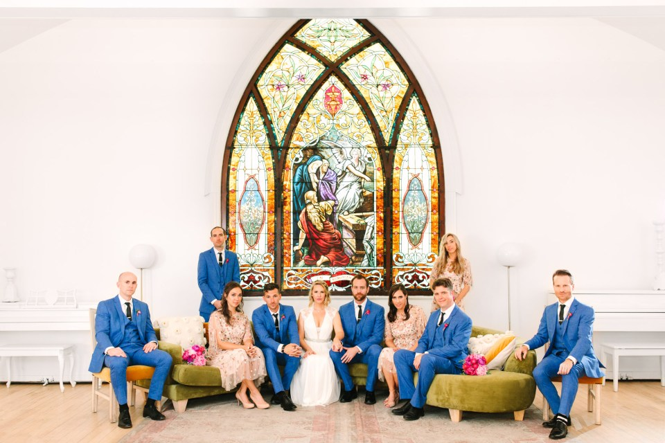 Wedding party with stained glass window at The Ruby Street Highland Park - www.marycostaweddings.com