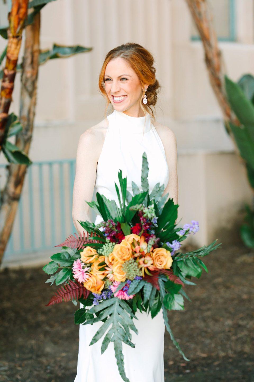Bride with wild wedding bouquet at San Diego Courthouse - www.marycostaweddings.com