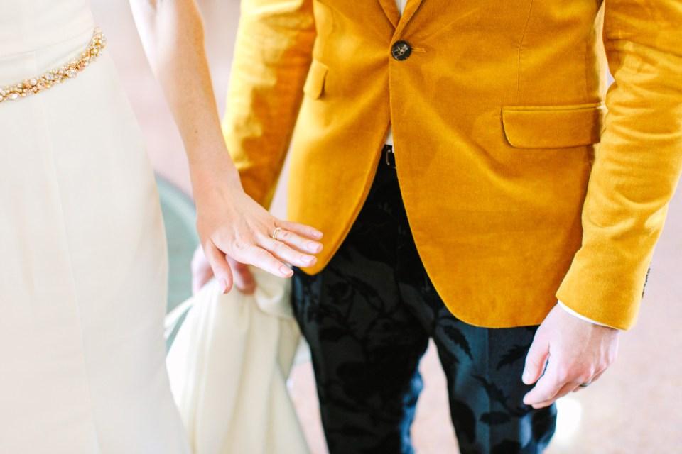 Bride looking at new wedding ring - www.marycostaweddings.com