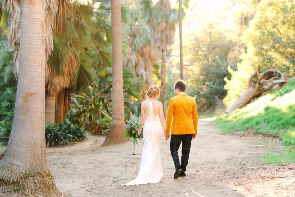 Couple walking in Balboa Park San Diego - www.marycostaweddings.com