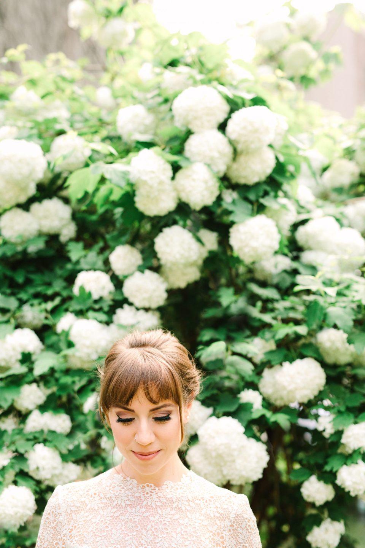 Bride in front of springtime blooms - www.marycostaweddings.com