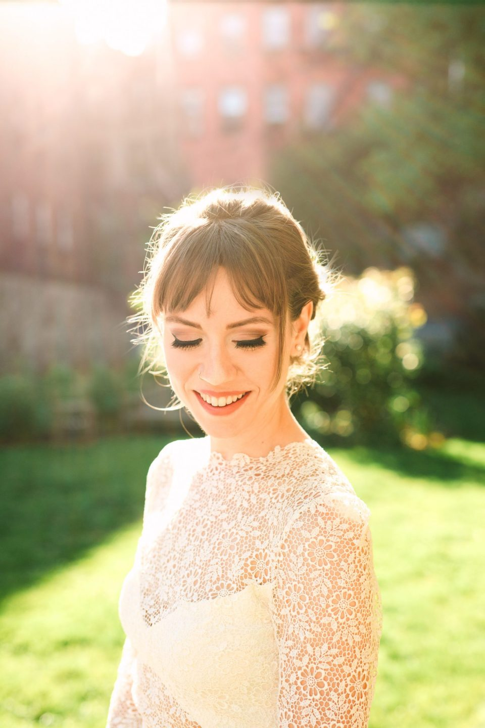 Backlit bride in NYC wearing Anais Anette gown - www.marycostaweddings.com