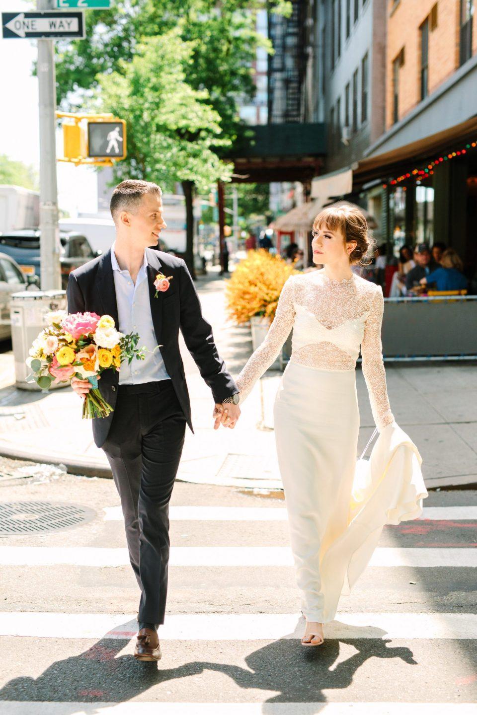 Bride and groom walking in NYC - www.marycostaweddings.com